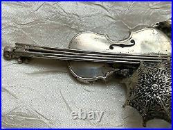 Antique Ethnic Silver Brooch -Scene w. Violin, flower, frog climbing on a ladder